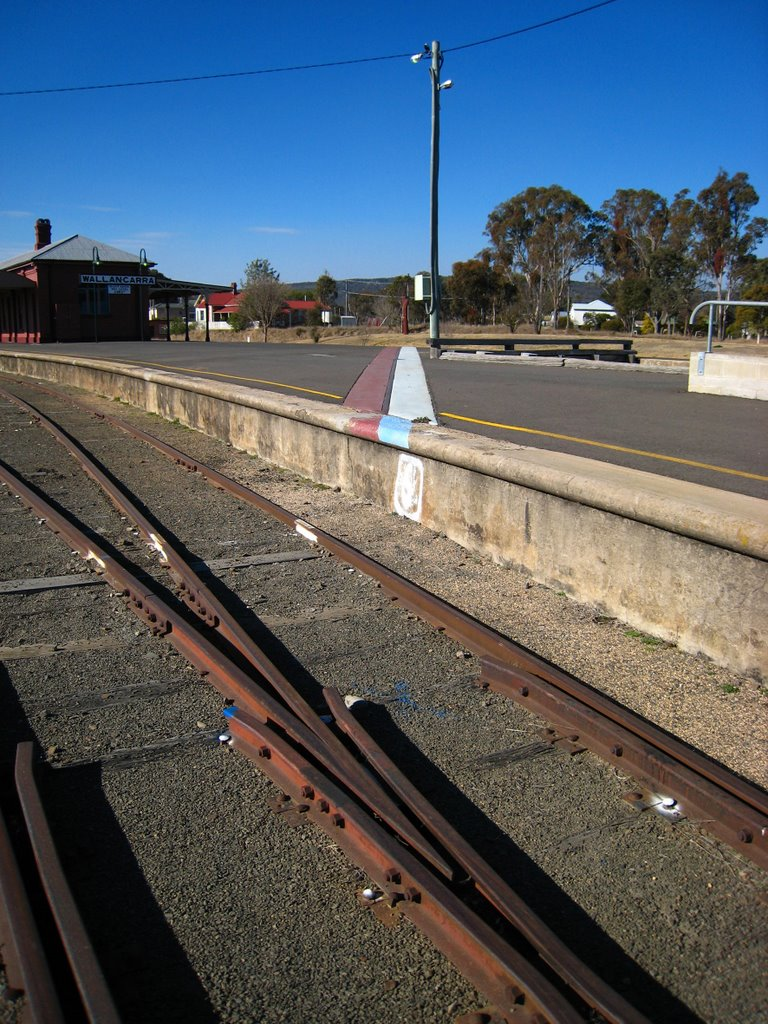 Wallangarra Railway Station. with the state border running across the platform. Queensland side on the left of the moroon line, New South Wales on the right of the blue line
