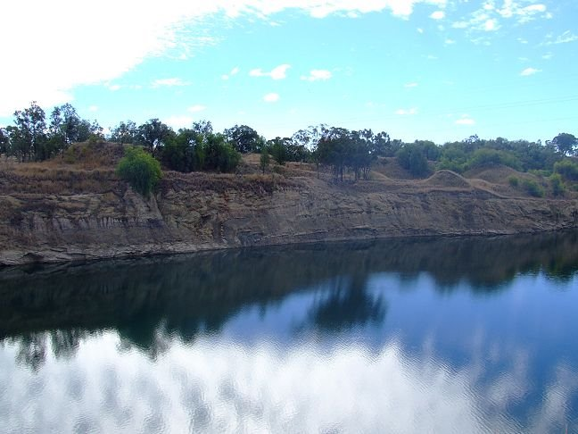 water-filled mining pit at Ashford Coal Mine with folded sediments