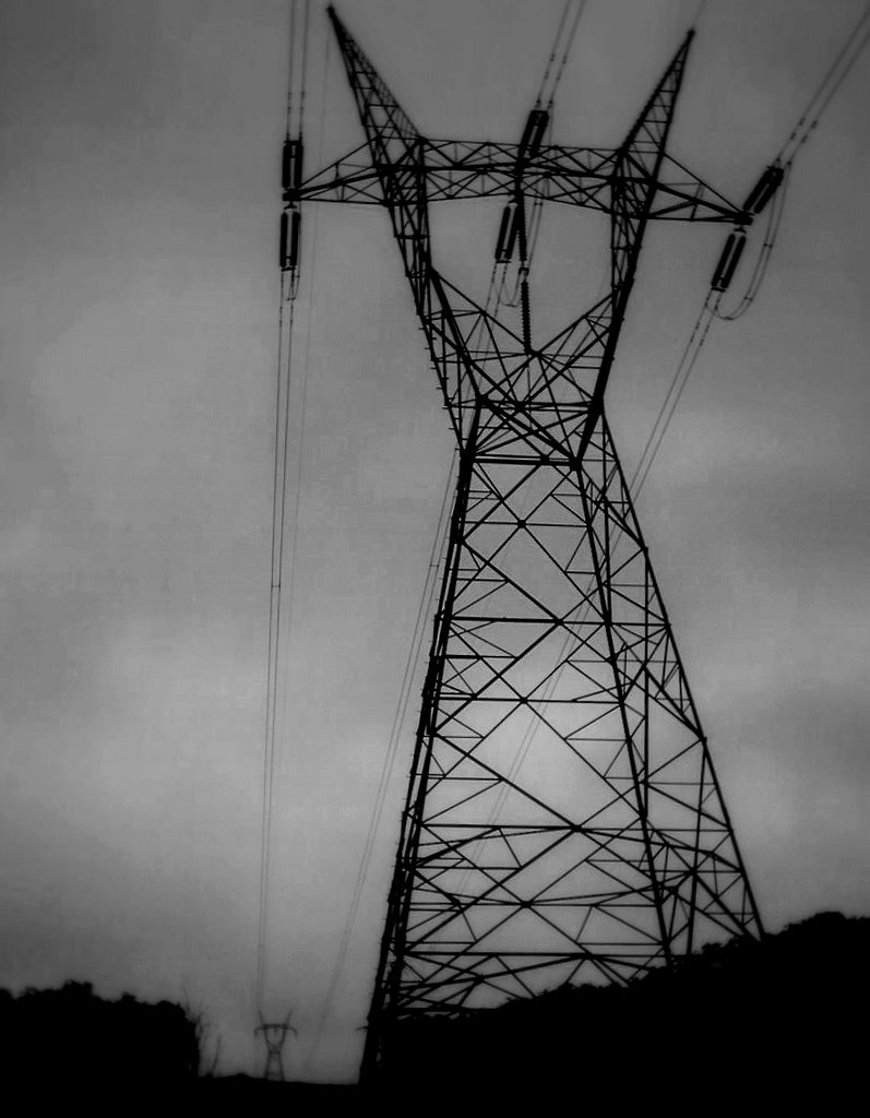 Pylons in the pouring rain, stark against the swollen sky...
