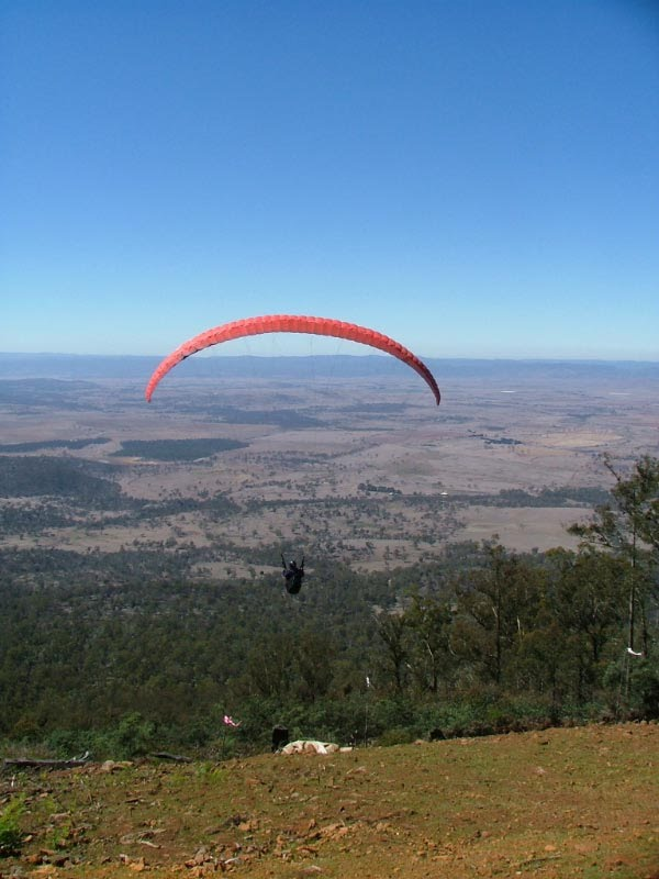 Paraglider launching at Tunbridge Tiers, Tasmania