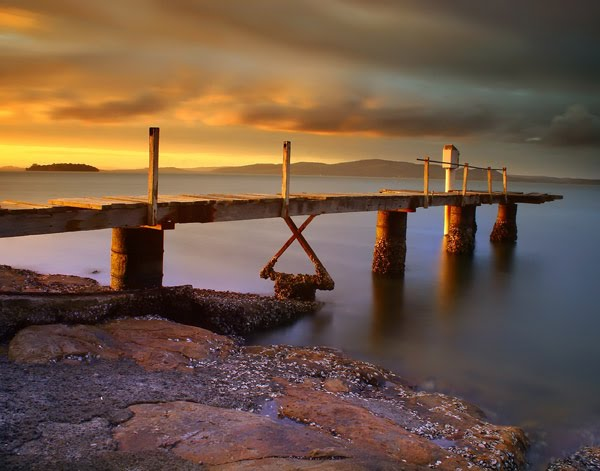 Sunset over jetty by David Gibbs