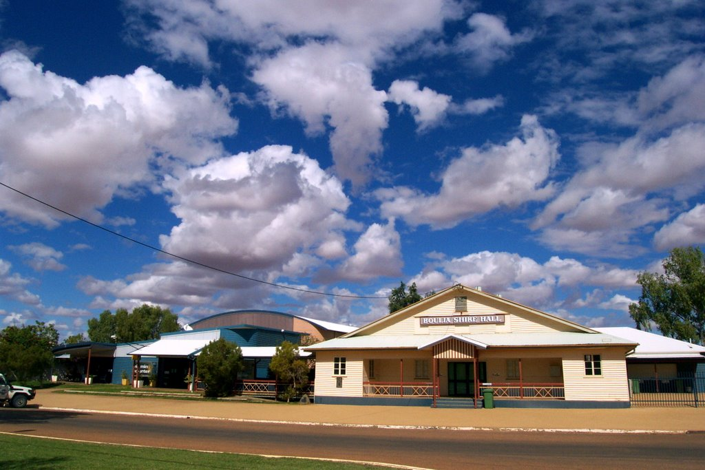 Boulia Shire Hall - sunlight reflected off the bare, red earth surrounding the town colours the undersides of the clouds
