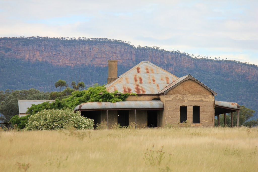 Abandoned farmhouse overlooked by Mt Nangar