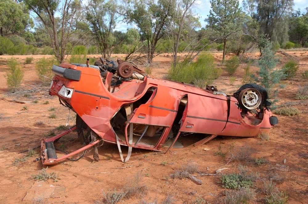 One of the thousands left to rust on outback roads