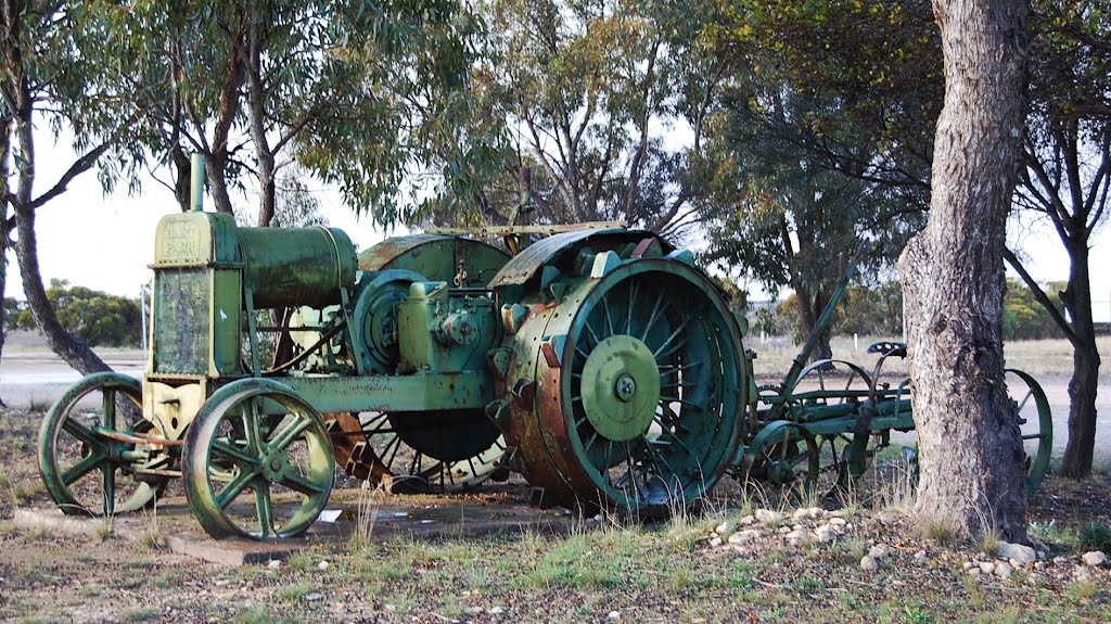 Labours done: historic steel-wheeled tractor and cultivator
